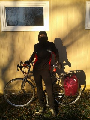 "Kristy ready for her bike commute to the office during the ""polar vortex.""  She uses two pairs of gloves in very cold weather due to poor circulation in her fingers and needs an extra layer in addition to wool tights to insulate around hips and thighs."