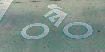 The green paint is great! But so are ponytails on the bicycle symbol. (Photo Credit to Charlotte, NC - way to go!)